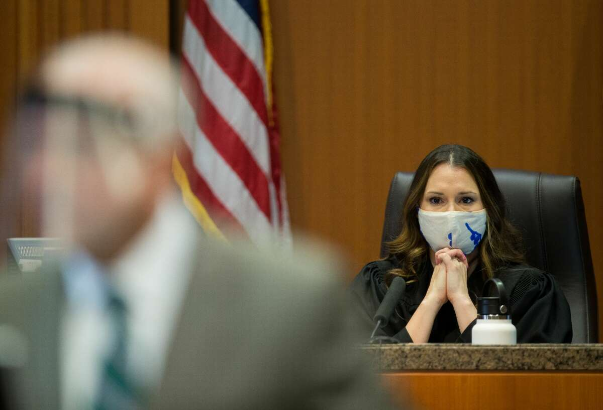 Judge Lauren Reeder, right, listens as plaintiff attorney Tom Cunningham delivers his opening statement as the trial against Baylor University and two former football players accused in a sexual assault case begins at 234th Court at Harris County Civil Courthouse, on Thursday, May 20, 2021, in Houston.