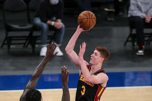 Atlanta Hawks guard Kevin Huerter, a Shenendehowa graduate, shoots over New York Knicks forward Julius Randle earlier this season. They'll meet in Game 1 of an NBA playoffs first-round series on May 23, 2021 at Madison Square Garden. (Associated Press)