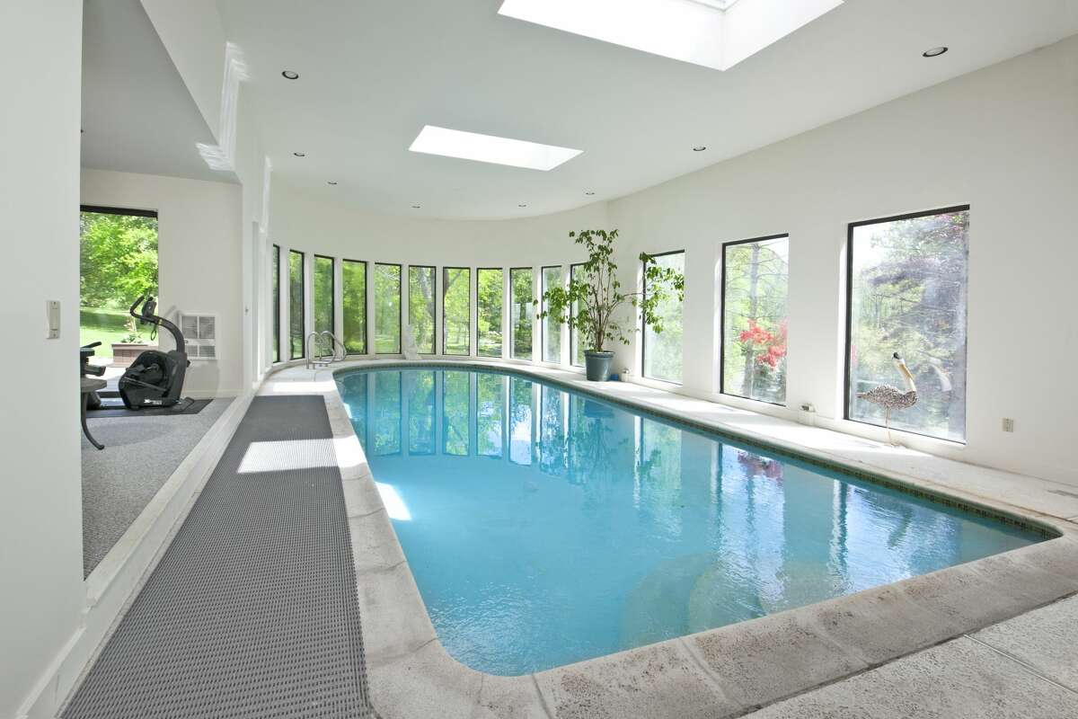 The home on 15 Laub Pond Road in Greenwich, Conn. has an indoor pool, which is where listing agent Mark Pruner said record-setting Greenwich High School swimmer Meghan Lynch developed her love of swimming.