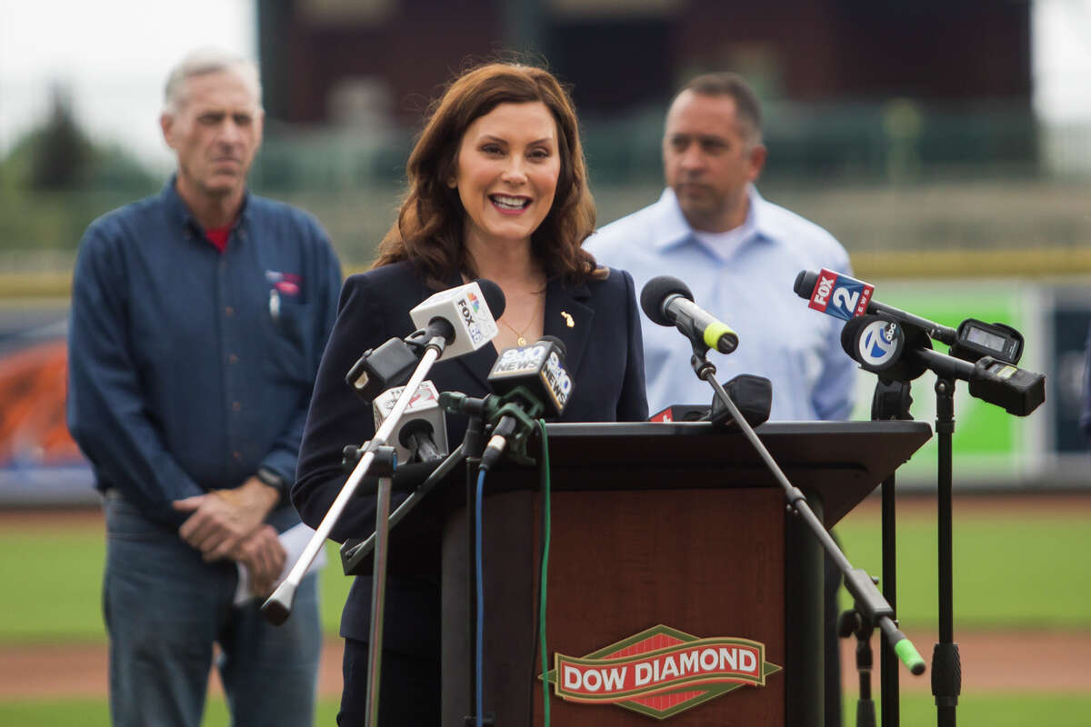 FILE - Gov. Gretchen Whitmer speaks during a press conference Thursday, May 20, 2021 at Dow Diamond in Midland, where she announced all outdoor capacity limits will be lifted across the state after June 1.