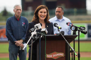 Gov. Gretchen Whitmer speaks during a press conference Thursday, May 20, 2021 at Dow Diamond in Midland, where she announced all outdoor capacity limits will be lifted across the state after June 1. Whitmer was joined by Lt. Gov. Garlin Gilchrist, Midland Mayor Maureen Donker, Dow CEO Jim Fitterling, Great Lakes Bay Regional Alliance President Matthew Felan and Great Lakes Loons President Chris Mundhenk. (Katy Kildee/kkildee@mdn.net)