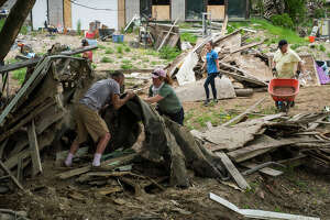 Volunteers work to clear debris from Porte Park as part of the Sanford Rising celebration in honor of the one-year anniversary of the May 2020 dam failures and flooding, on Thursday, May 20, 2021 in downtown Sanford. (Katy Kildee/kkildee@mdn.net)