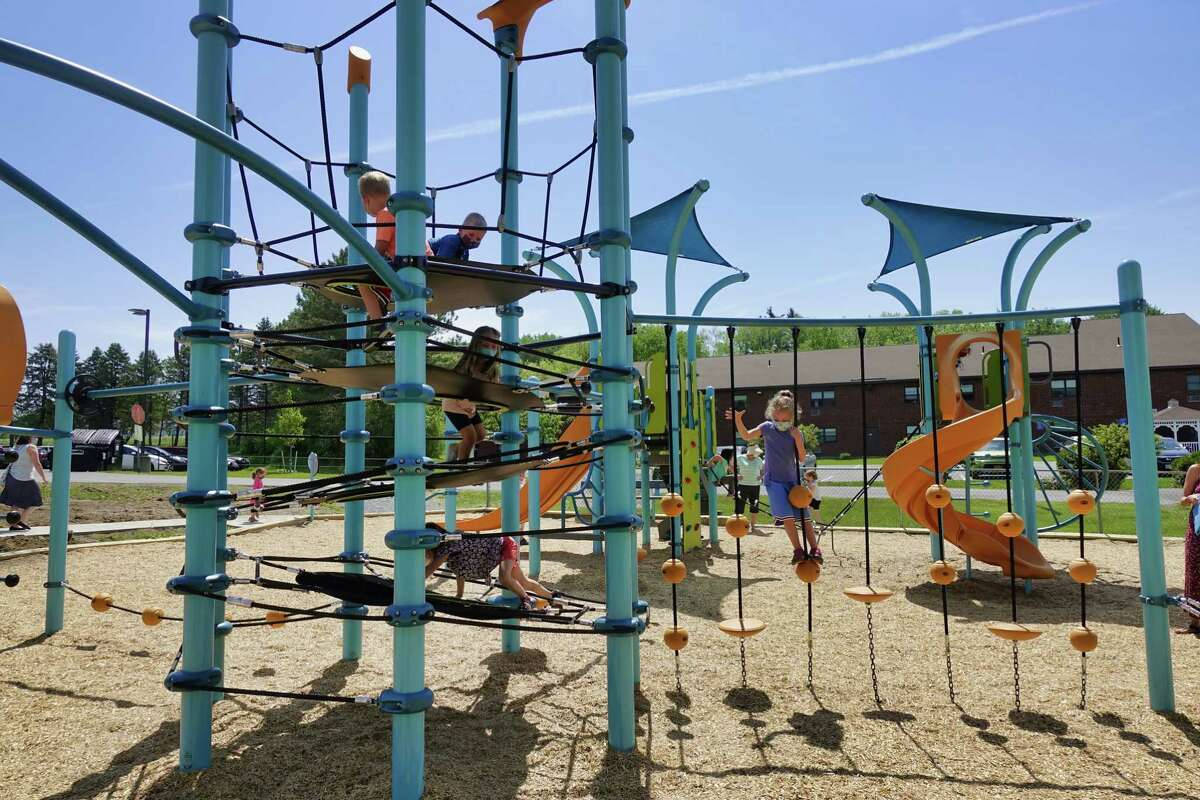 Children play on the newly opened playground at the Schenectady Jewish Community Center on Thursday, May 20, 2021, in Schenectady, N.Y.