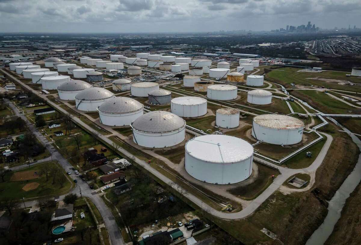 Storage tanks dot the landscape adjacent to a neighborhood northeast of downtown Houston on March 11, 2021. Insiders worry Texas politicians are looking for a simple fix for the unreliable power grid, as opposed to creating a more resilient system capable of handling extreme weather.