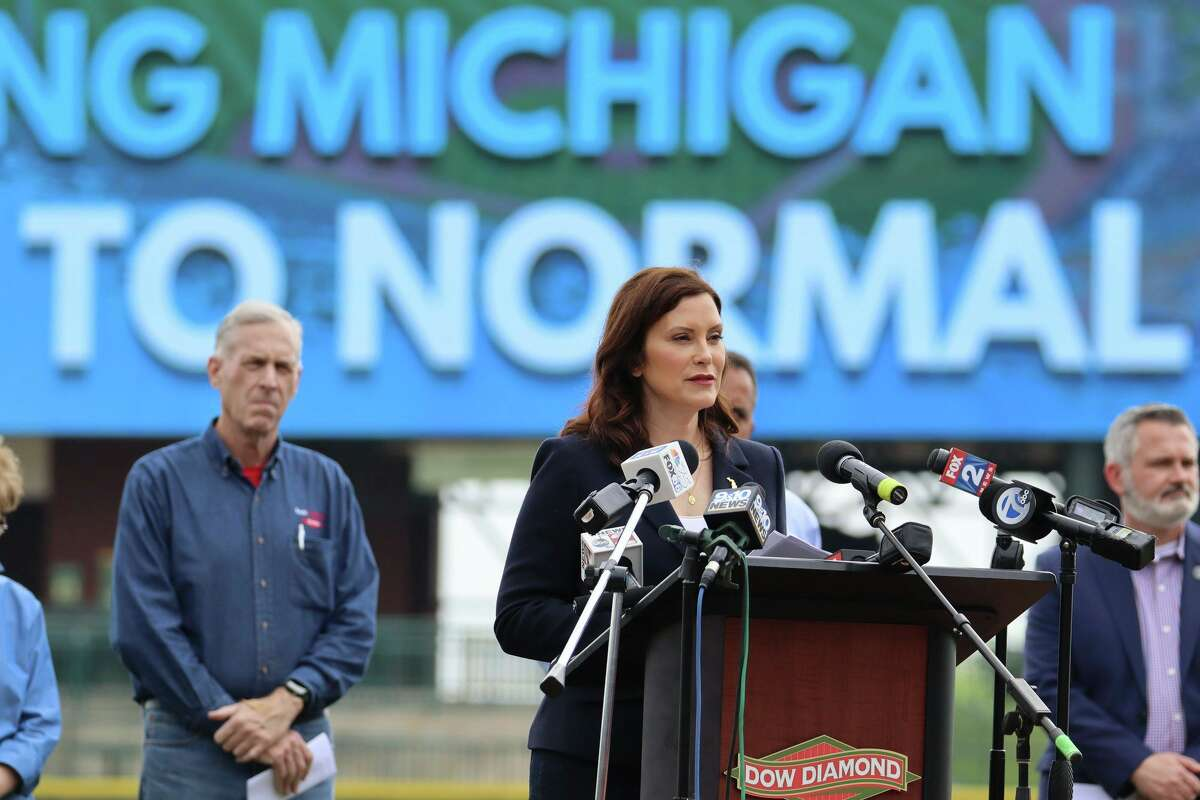 Gov. Gretchen Whitmer announces during a news conference Thursday in Midland, an accelerated plan to remove pandemic restrictions by July 1. (Courtesy photo/State of Michigan)