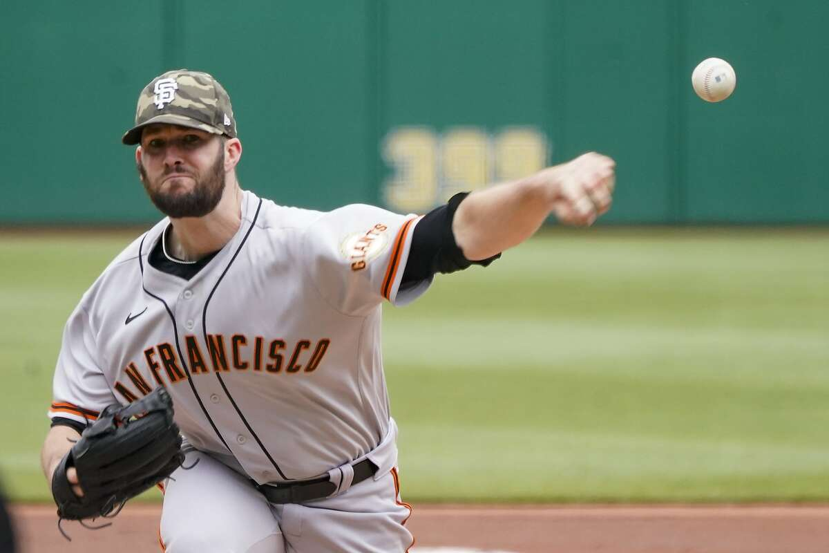 San Francisco Giants starter Alex Wood pitches against the Pittsburgh Pirates in a baseball game, Sunday, May 16, 2021, in Pittsburgh. (AP Photo/Keith Srakocic)