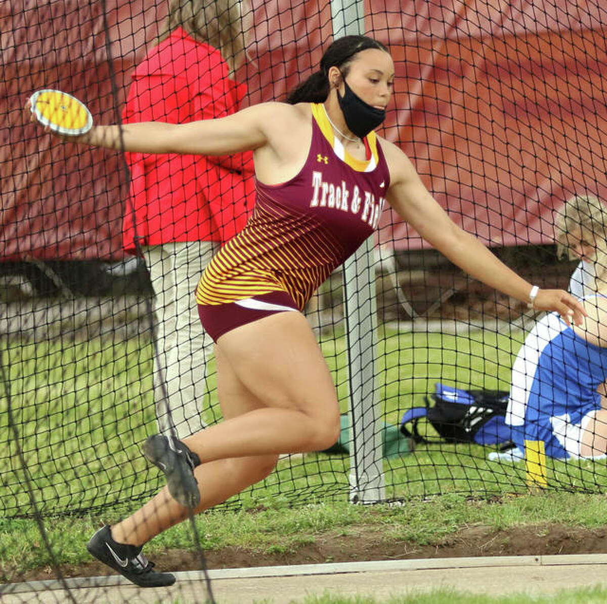 EA-WR senior Jayden Ulrich gets off a throw of 161 feet, 7 inches to set a girls track county record at the Madison County Meet on Monday in Wood River.