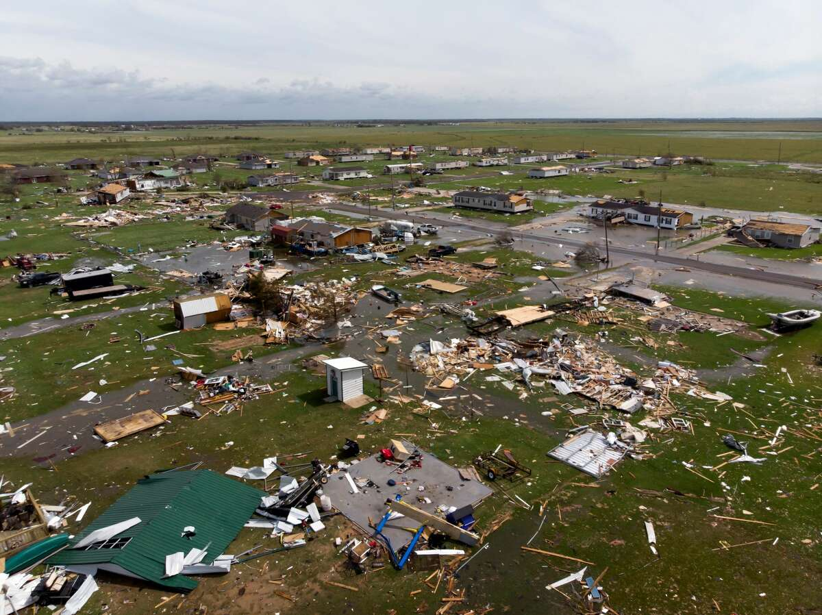 This aerial view shows damage to a neighborhood by Hurricane Laura outside of Lake Charles, Louisiana, on August 27, 2020. (Photo by STRINGER/AFP via Getty Images)