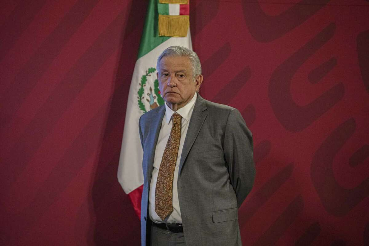 Andres Manuel Lopez Obrador, Mexico's president, stands during a news conference at the National Palace in Mexico City, last year. AMLO's morning press conference is a gladiator's arena in which the reputation of a person in the public sphere, a company, organization, or government agency can be mauled by derogatory claims and insinuations, the author writes.