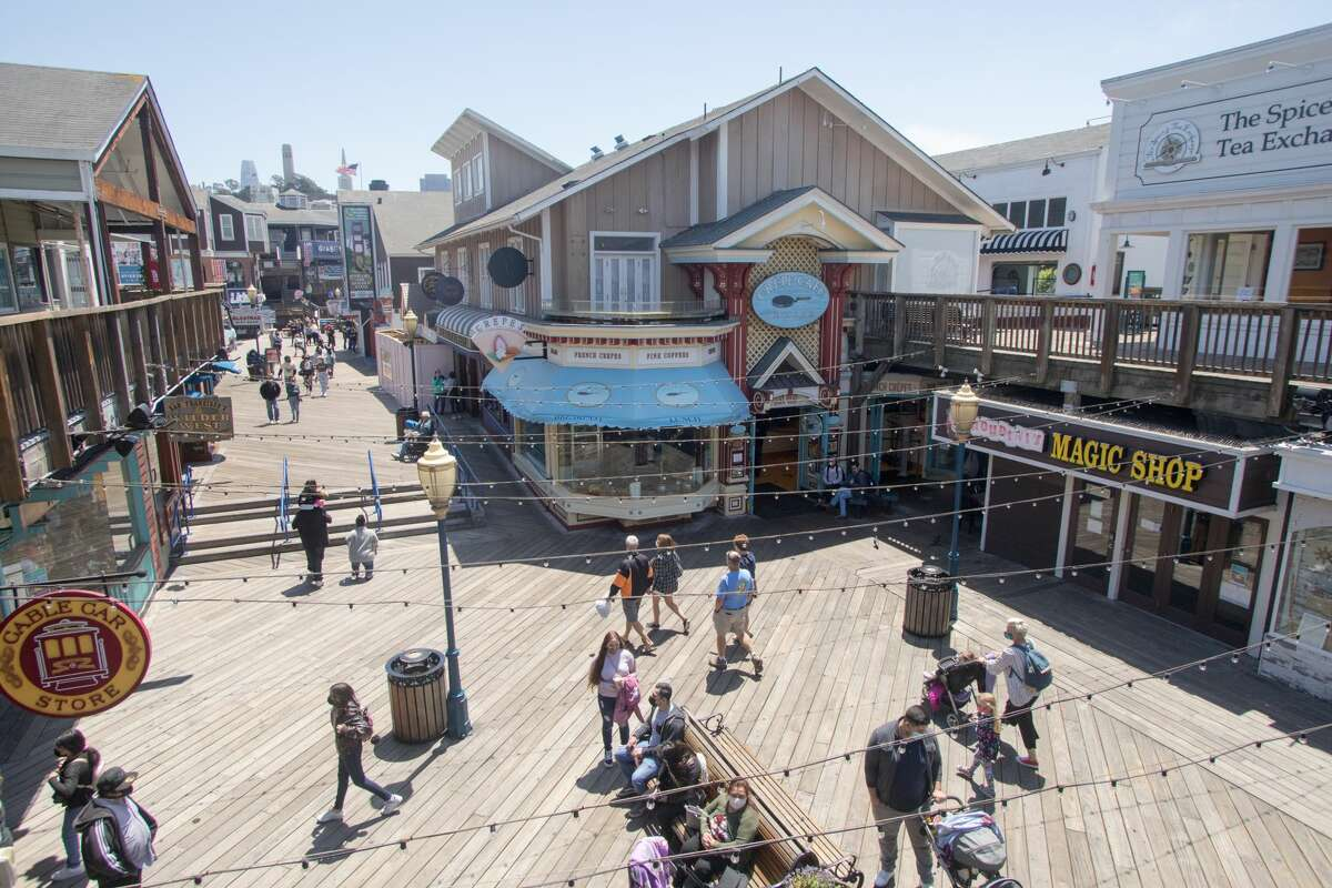 Visitors at Pier 39 in San Francisco on May 12, 2021. Most restaurants in San Francisco have had very few issues over the city's vaccine card check requirement, but restaurants in tourist-facing areas such as Pier 39 have worked hard to ensure that incoming customers know of the mandate.