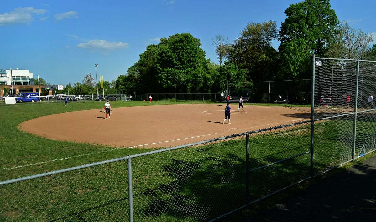 The Brien McMahon High School softball field in front of the school Tuesday, May 18, 2021, in Norwalk, Conn. The Zoning Commission on Wednesday approved planned upgrades to the softball field. The city plans to install turf and new lighting. The project has sparked concern among Highland Avenue residents.