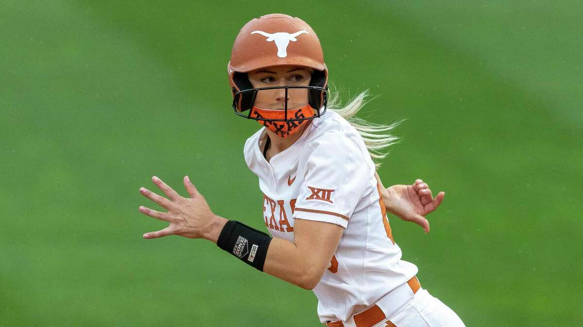 Texas' Lauren Burke watches the Oklahoma State pitcher during an NCAA softball game on Saturday, May 1, 2021, in Austin, Texas (AP Photo/Stephen Spillman)