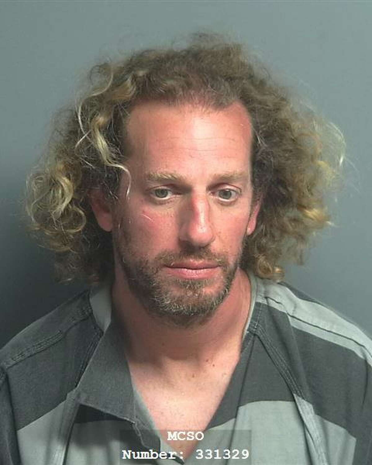 Roi Amrani, 42, of The Woodlands, is charged with invasive visual recording, a state jail felony.