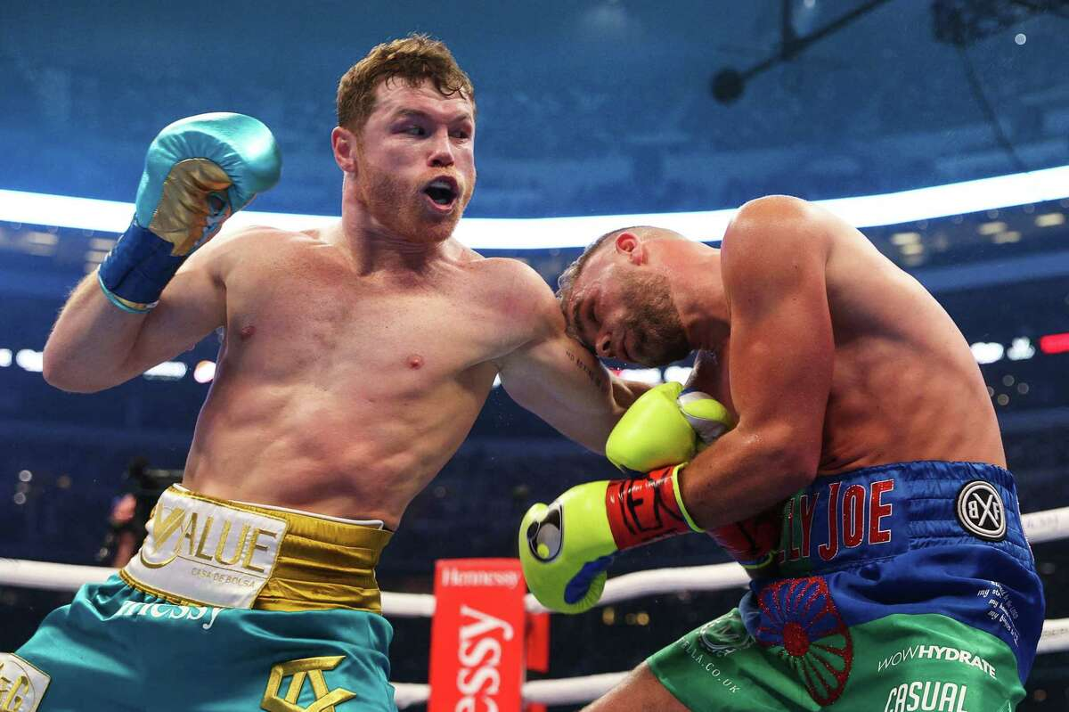 TOPSHOT - In this handout photo provided by Matchroom Boxing, Mexican boxer Saul