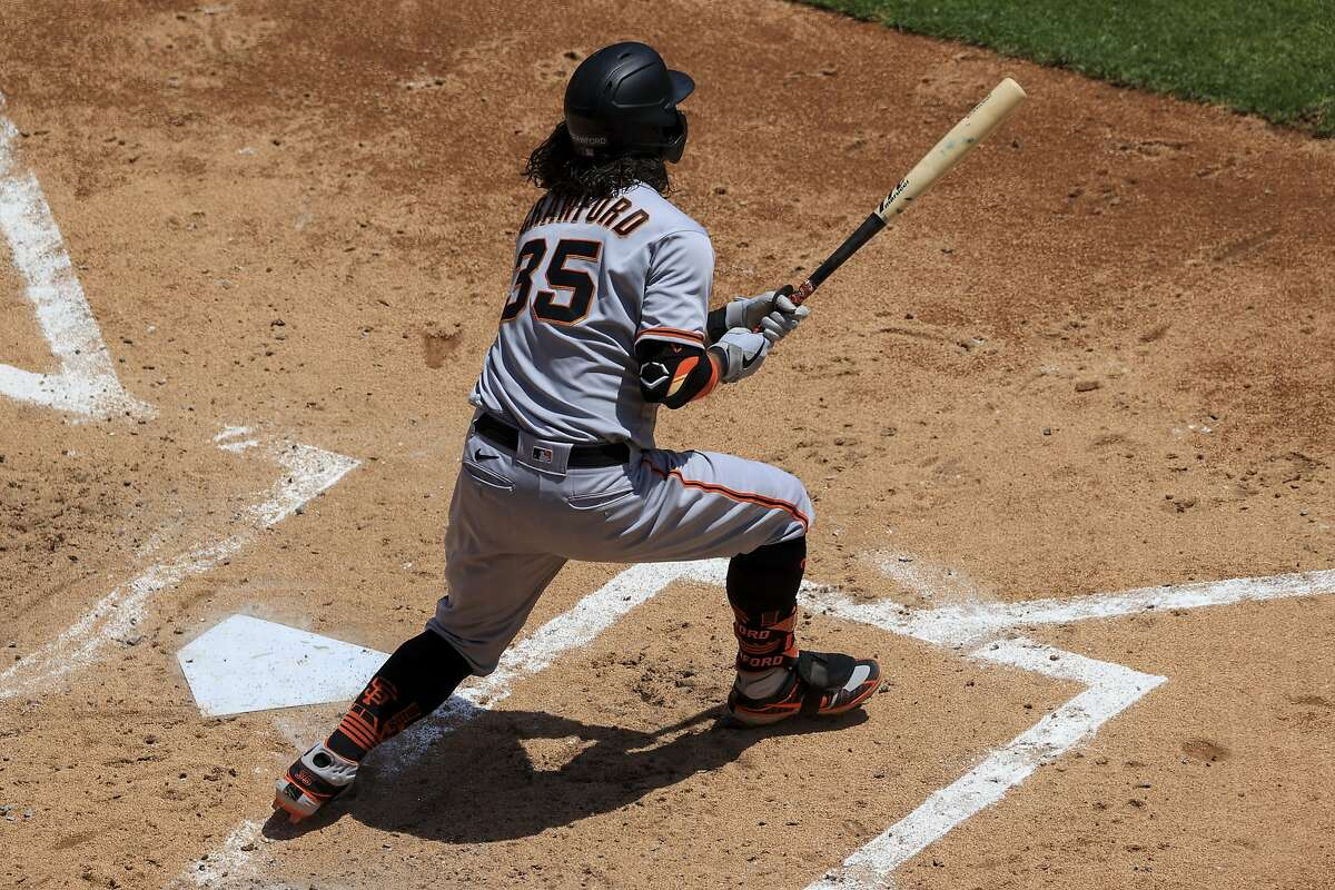 San Francisco Giants' Brandon Crawford hits an RBI single during the third inning of a baseball game against the San Francisco Giants in Cincinnati, Thursday, May 20, 2021. (AP Photo/Aaron Doster)