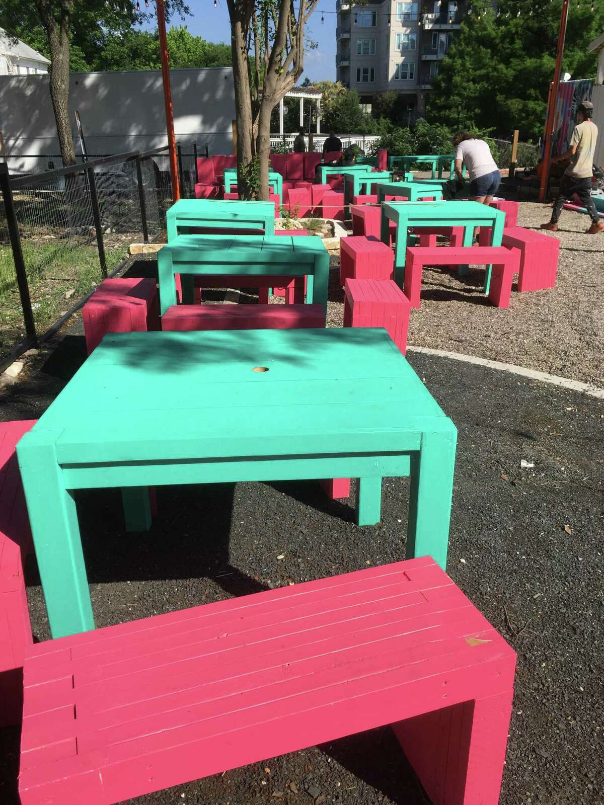 El Camino features a large deck and outdoor seating at bright pink and turquoise tables and chairs.