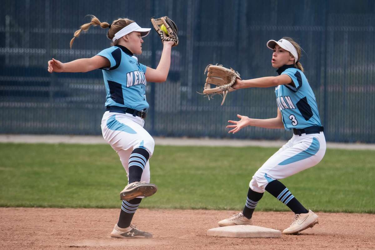 Meridian's Ally Sutton catches a pop-up while teammate Taylor Hopkins looks on during an April 8, 2021 game against Dow High.