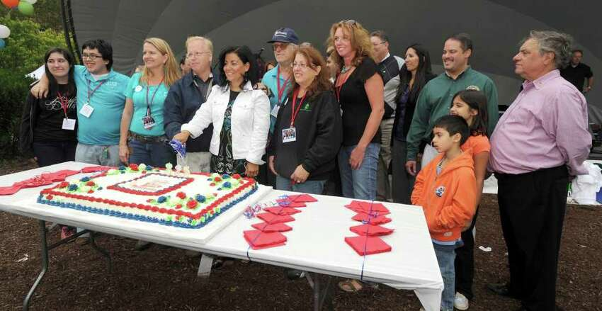 Danbury Mayor Mark Boughton, center with wife Phyllis, surrounded by other officials, pose for a photo with the cities birthday cake. The City of Danbury is celebrating it's 325th birthday. Photo taken Sunday, Sept. 12, 2010.