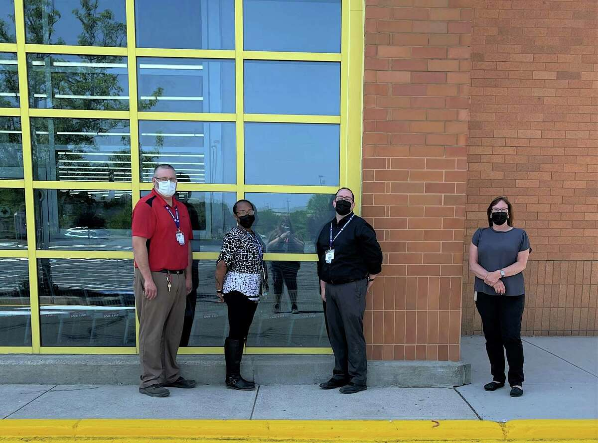 Danbury Ocean State Job Lot store team leader Rich Stomski, area team leaders Desiree McLaughlin and Eric Masters, and district team leader Sue Lamparelli stand outside the new store on Backus Avenue in Danbury, Conn.