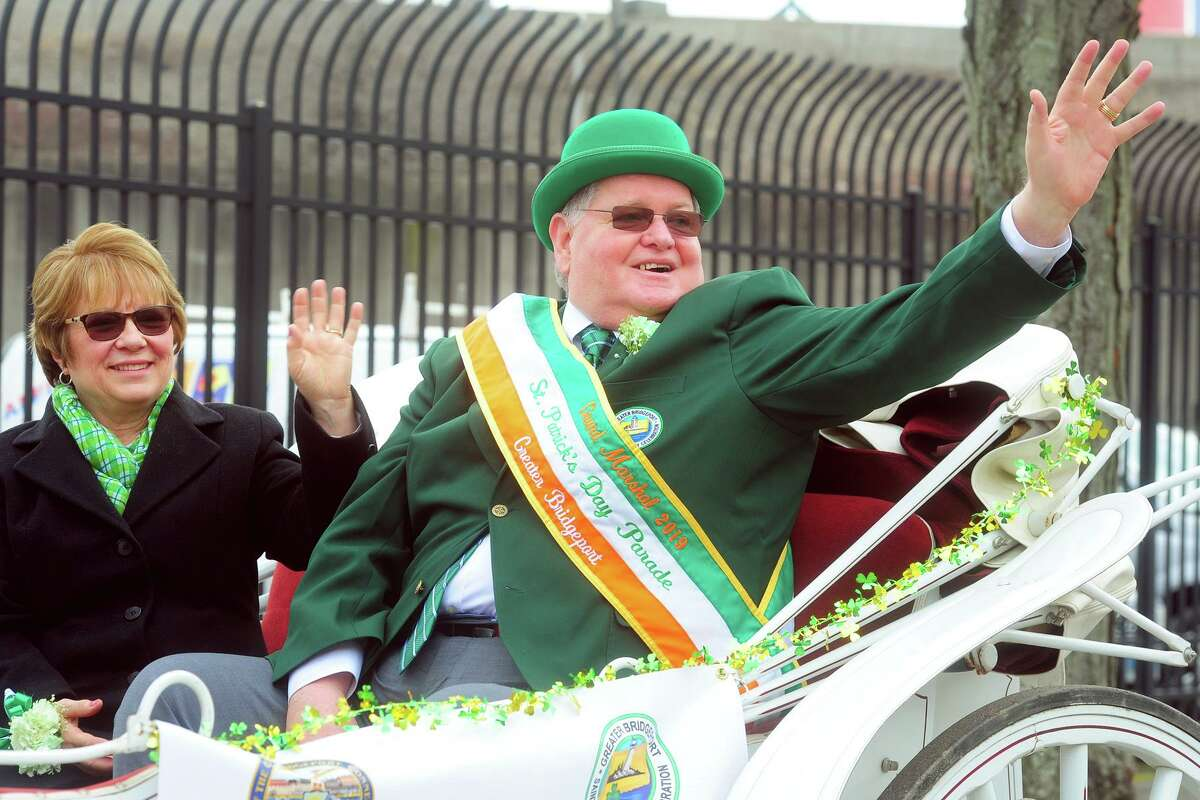 Grand Marshall Peter Carroll and his wife Joan wave to the crowd during the Greater Bridgeport St. Patrick's Day Parade, in downtown Bridgeport, Conn. March 15, 2019.