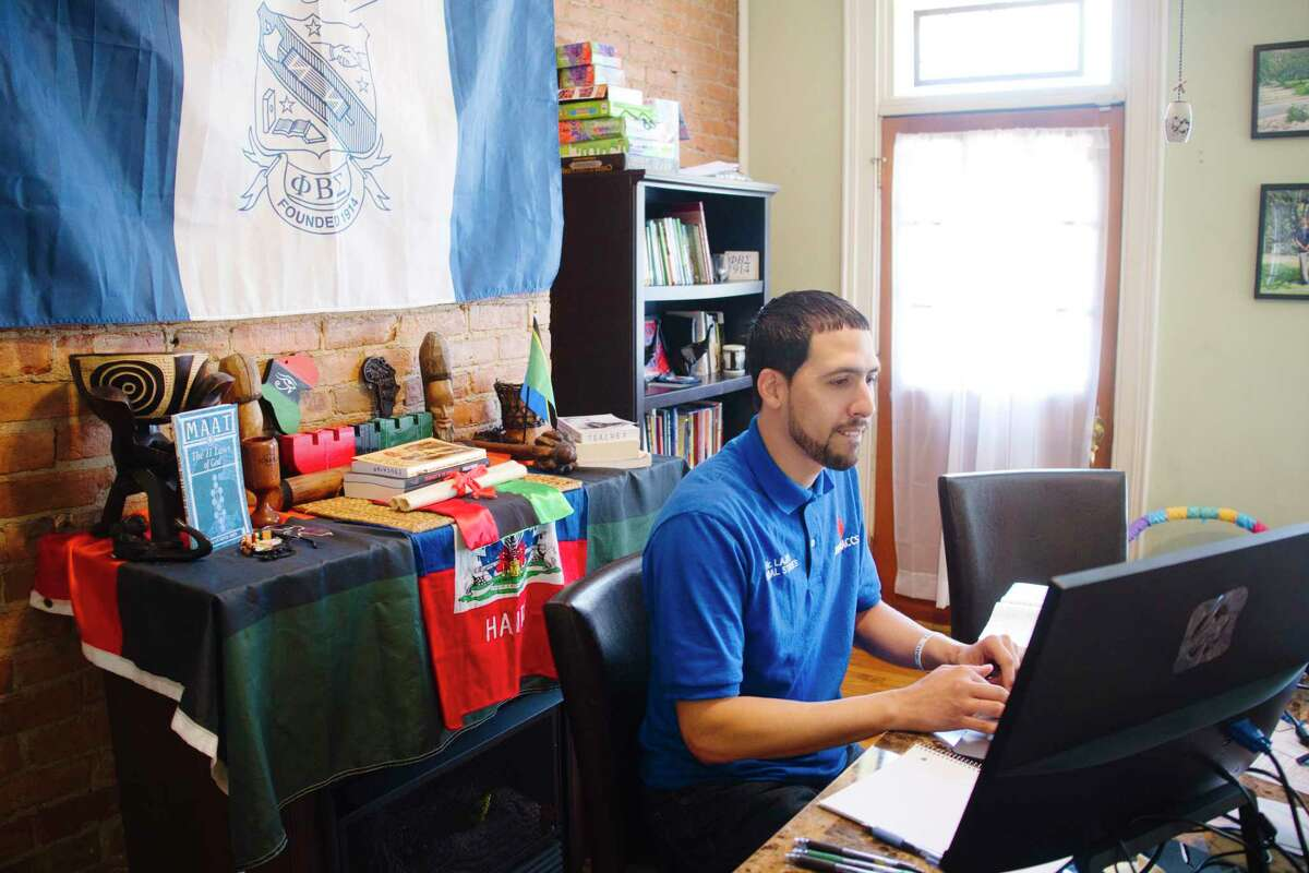 Jonathan Lajas, a social studies teacher at KIPP, teaches students online from his home on Tuesday, May 11, 2021, in Albany, N.Y. (Paul Buckowski/Times Union)
