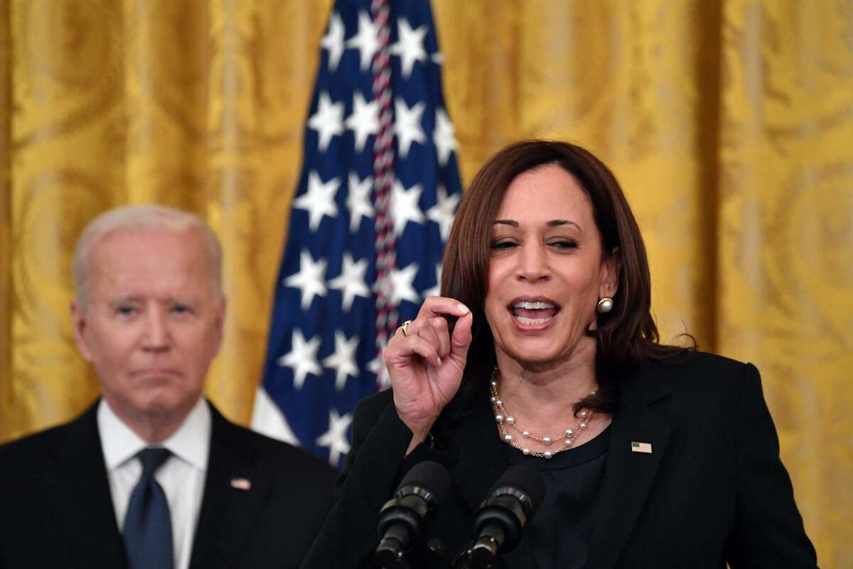 Vice President Kamala Harris delivers remarks as U.S. President Joe Biden listens before signing the COVID-19 Hate Crimes Act in the East Room of the White House in Washington, D.C., on May 20, 2021.