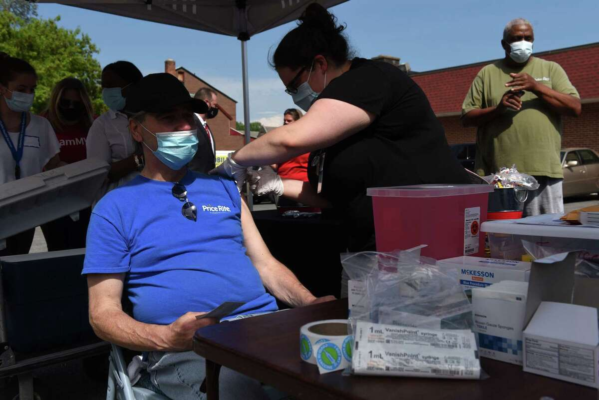 Tim Tocco of Schenectady is vaccinated against COVID-19 during a popup mobile vaccination clinic on Thursday afternoon, May 20, 2021, at the Schenectady Inner City Mission location on Albany Street in Schenectady, N.Y. The New York County Executives Association sent a letter to the state Health Department in August asking for data that shows how many vaccinated people have been hospitalized. (Will Waldron/Times Union)