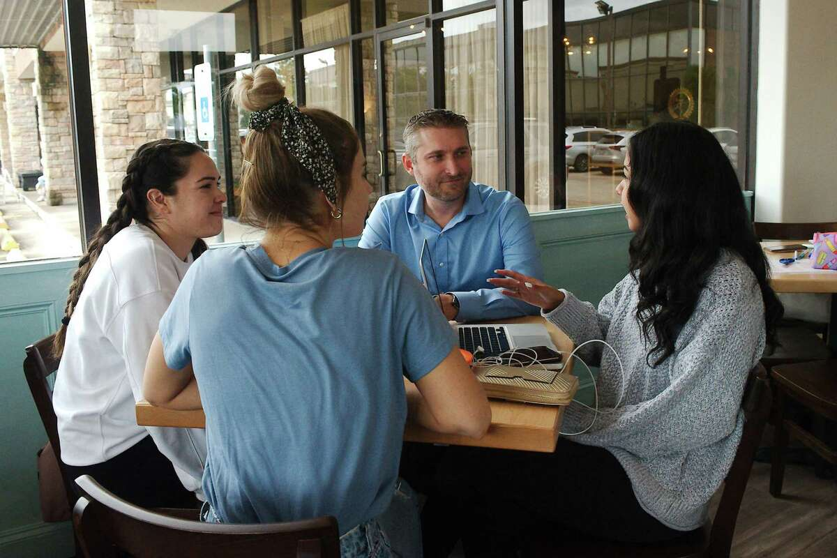 Newly elected Clear Creek ISD trustee Jonathan Cottrell says his background in advocating for district needs in various volunteer positions will help him in his new role. He chats with Alexis Glover, left, Rachel Payne and Carloyn Ramirez at Java Owl, a popular meeting spot in Nassau Bay.