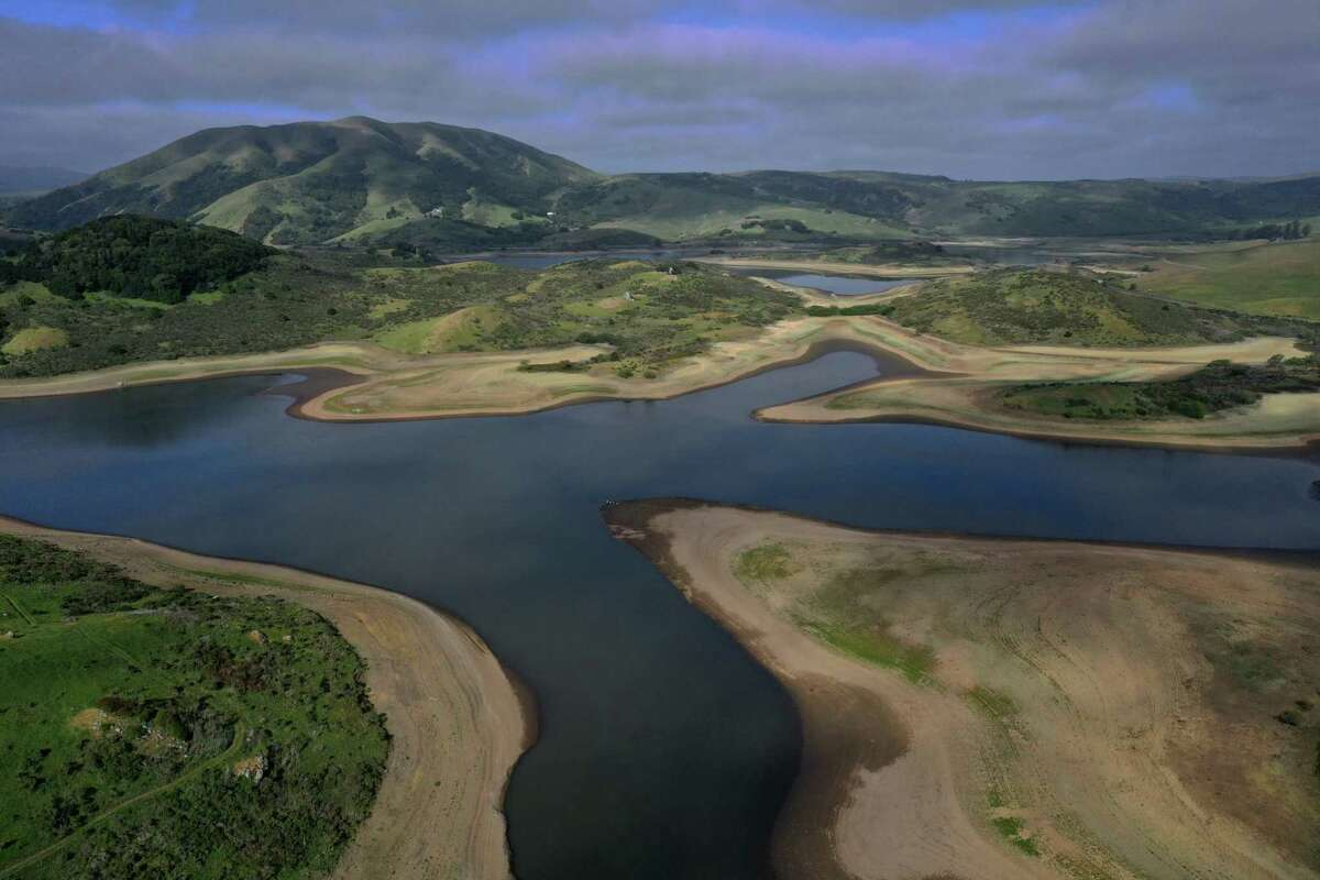 The Nicasio Reservoir in Marin County reveals the low water levels plaguing California reservoirs. As a heat wave exacerbates the state's drought, Gov. Gavin Newsom has asked residents to voluntarily cut their water use by 15% and extended an emergency drought declaration to nearly every Bay Area county, including Marin.