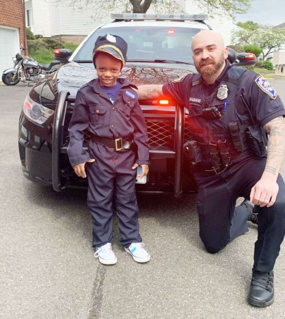Middletown High School Resource Officer Emilio Magnano surprised 5-year-old Kanaan Boateng at his fifth birthday party recently, presenting him with a police costume from his mother. His mother, Kiarra Bennett, said Kanaan got into the cruiser mid-party and asked Magnano when they were going to work.