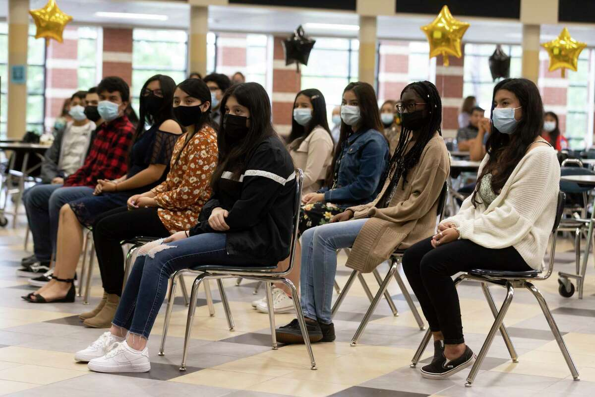 Recipients of the All Means All scholarship listen to speakers during the event at Conroe 9th Grade High School, Wednesday, May 19, 2021, in Conroe. Over 12 students were awarded $2,000 scholarships during the event which will be given to them at the end of their senior year.