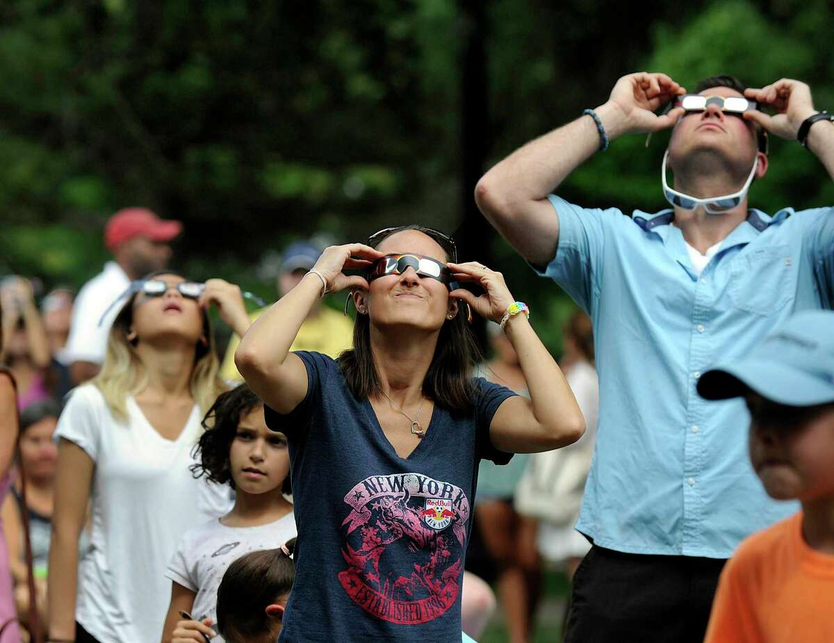 Tanya and Ording of Ridgefield view the solar eclipse at Ballard Park in Ridgefield Monday, August 21, 2017.