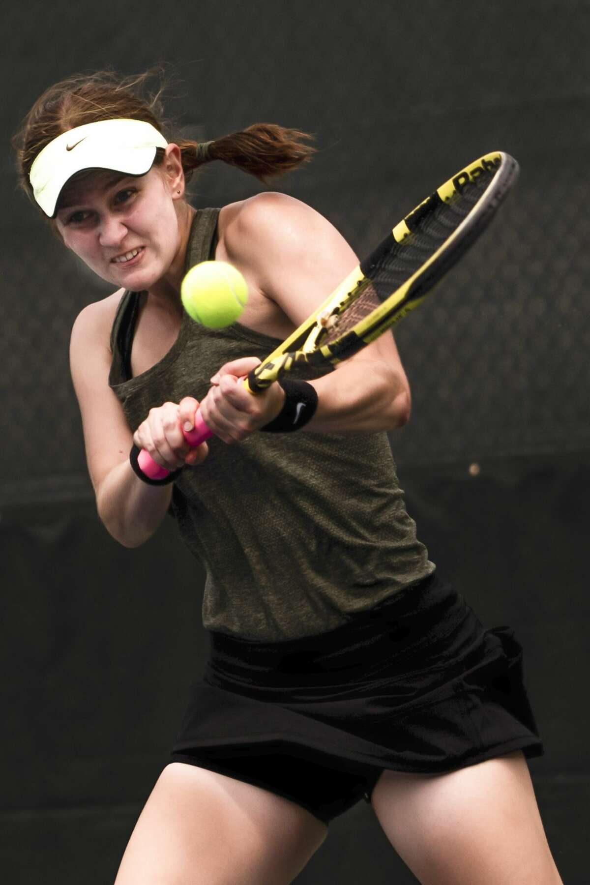 Dow's Zoe Angell faces an opponent in the second round of the MHSAA Division 1 Region 8 Girls Tennis Championship May 20, 2021 at the Greater Midland Tennis Center in Midland. (Isaac Ritchey/for the Daily News)