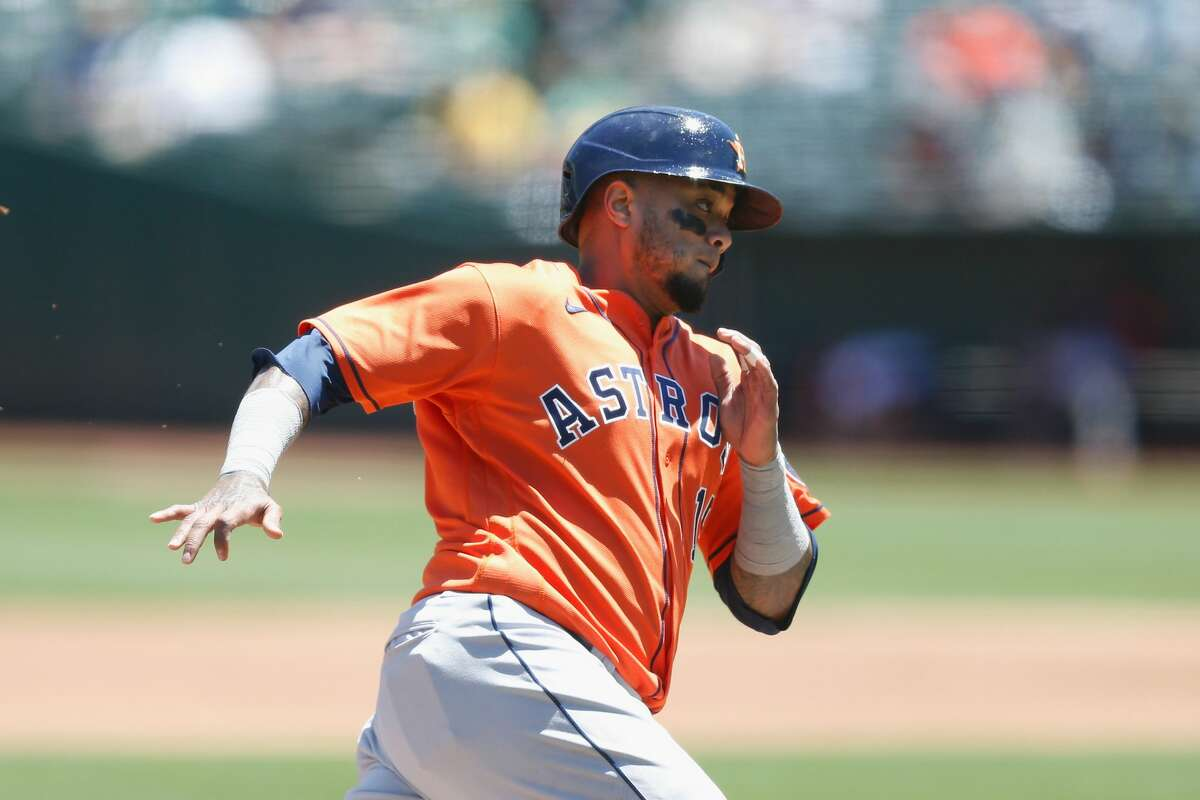 OAKLAND, CALIFORNIA - MAY 20: Martin Maldonado #15 of the Houston Astros rounds third base to score on a single by Michael Brantley #23 in the top of the third inning against the Oakland Athletics at RingCentral Coliseum on May 20, 2021 in Oakland, California. (Photo by Lachlan Cunningham/Getty Images)