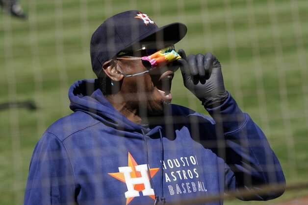 Houston Astros manager Dusty Baker Jr. lifts his face mask as he looks toward fans during the seventh inning of the team's baseball game against the Oakland Athletics in Oakland, Calif., Thursday, May 20, 2021. (AP Photo/Jeff Chiu) Photo: Jeff Chiu/Associated Press / Copyright 2021 The Associated Press. All rights reserved
