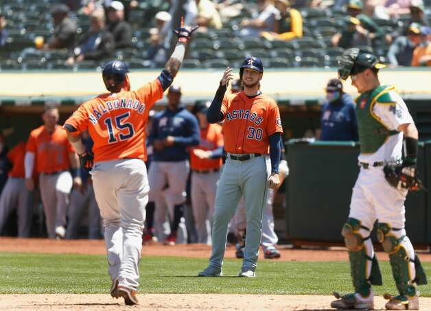 OAKLAND, CALIFORNIA - MAY 20: Kyle Tucker #30 and Martin Maldonado #15 of the Houston Astros celebrate after a two-run home run by Maldonado in the top of the fourth inning against the Oakland Athletics at RingCentral Coliseum on May 20, 2021 in Oakland, California. (Photo by Lachlan Cunningham/Getty Images) Photo: Lachlan Cunningham/Getty Images / 2021 Getty Images