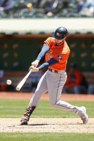 OAKLAND, CALIFORNIA - MAY 20: Kyle Tucker #30 of the Houston Astros hits a double in the top of the third inning against the Oakland Athletics at RingCentral Coliseum on May 20, 2021 in Oakland, California. (Photo by Lachlan Cunningham/Getty Images) Photo: Lachlan Cunningham/Getty Images / 2021 Getty Images