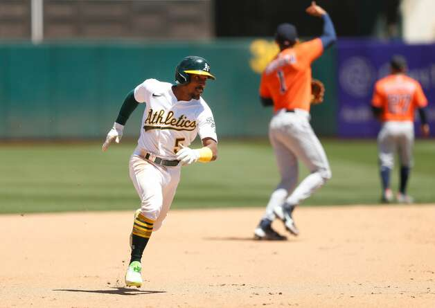 OAKLAND, CALIFORNIA - MAY 20: Tony Kemp #5 of the Oakland Athletics runs to third base on a single by Mark Canha #20 in the bottom of the fifth inning against the Houston Astros at RingCentral Coliseum on May 20, 2021 in Oakland, California. (Photo by Lachlan Cunningham/Getty Images) Photo: Lachlan Cunningham/Getty Images / 2021 Getty Images