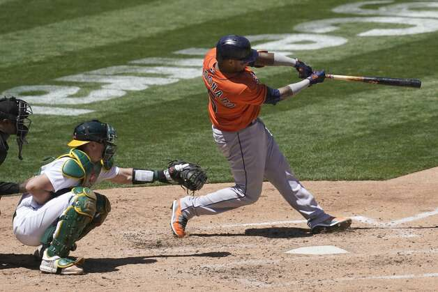 Houston Astros' Martin Maldonado, right, hits a two-run home run in front of Oakland Athletics catcher Sean Murphy during the fourth inning of a baseball game in Oakland, Calif., Thursday, May 20, 2021. (AP Photo/Jeff Chiu) Photo: Jeff Chiu/Associated Press / Copyright 2021 The Associated Press. All rights reserved