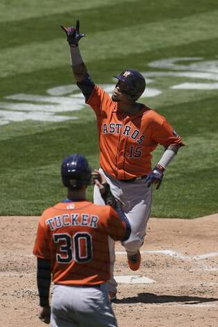Houston Astros' Martin Maldonado (15) celebrates after hitting a two-run home run that scored Kyle Tucker (30) in the fourth inning of a baseball game against the Oakland Athletics in Oakland, Calif., Thursday, May 20, 2021. (AP Photo/Jeff Chiu) Photo: Jeff Chiu/Associated Press / Copyright 2021 The Associated Press. All rights reserved