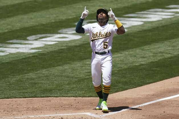 Oakland Athletics' Tony Kemp celebrates after hitting a home run against the Houston Astros during the third inning of a baseball game in Oakland, Calif., Thursday, May 20, 2021. (AP Photo/Jeff Chiu) Photo: Jeff Chiu/Associated Press / Copyright 2021 The Associated Press. All rights reserved