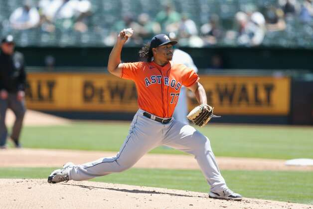 OAKLAND, CALIFORNIA - MAY 20: Luis Garcia #77 of the Houston Astros pitches in the bottom of the second inning against the Oakland Athletics at RingCentral Coliseum on May 20, 2021 in Oakland, California. (Photo by Lachlan Cunningham/Getty Images) Photo: Lachlan Cunningham/Getty Images / 2021 Getty Images