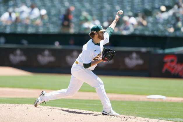 OAKLAND, CALIFORNIA - MAY 20: Cole Irvin #19 of the Oakland Athletics pitches in the top of the second inning against the Houston Astros at RingCentral Coliseum on May 20, 2021 in Oakland, California. (Photo by Lachlan Cunningham/Getty Images) Photo: Lachlan Cunningham/Getty Images / 2021 Getty Images