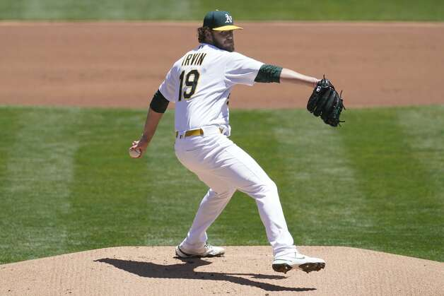 Oakland Athletics' Cole Irvin pitches against the Houston Astros during the first inning of a baseball game in Oakland, Calif., Thursday, May 20, 2021. (AP Photo/Jeff Chiu) Photo: Jeff Chiu/Associated Press / Copyright 2021 The Associated Press. All rights reserved