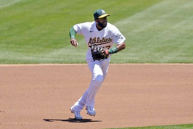 Oakland Athletics shortstop Elvis Andrus (17) throws out Houston Astros' Alex Bregman at first base during the first inning of a baseball game in Oakland, Calif., Thursday, May 20, 2021. (AP Photo/Jeff Chiu) Photo: Jeff Chiu/Associated Press / Copyright 2021 The Associated Press. All rights reserved