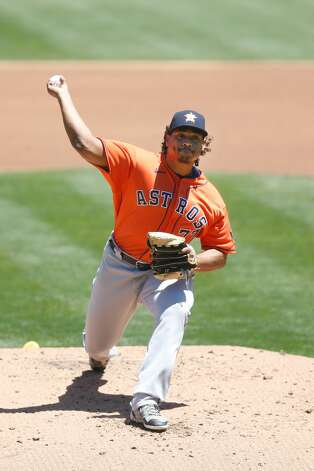 OAKLAND, CALIFORNIA - MAY 20: Luis Garcia #77 of the Houston Astros pitches in the bottom of the first inning against the Oakland Athletics at RingCentral Coliseum on May 20, 2021 in Oakland, California. (Photo by Lachlan Cunningham/Getty Images) Photo: Lachlan Cunningham/Getty Images / 2021 Getty Images