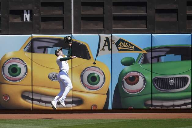 Oakland Athletics left fielder Mark Canha (20) catches a fly out hit by Houston Astros' Jose Altuve during the first inning of a baseball game in Oakland, Calif., Thursday, May 20, 2021. (AP Photo/Jeff Chiu) Photo: Jeff Chiu/Associated Press / Copyright 2021 The Associated Press. All rights reserved