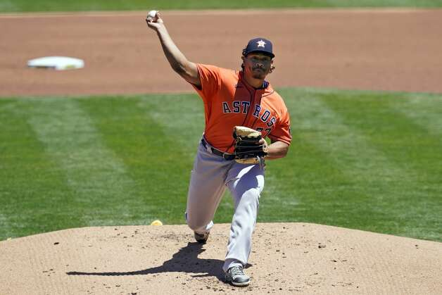 Houston Astros' Luis Garcia pitches against the Oakland Athletics during the first inning of a baseball game in Oakland, Calif., Thursday, May 20, 2021. (AP Photo/Jeff Chiu) Photo: Jeff Chiu/Associated Press / Copyright 2021 The Associated Press. All rights reserved