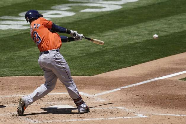 Houston Astros' Michael Brantley hits an RBI-single against the Oakland Athletics during the third inning of a baseball game in Oakland, Calif., Thursday, May 20, 2021. (AP Photo/Jeff Chiu) Photo: Jeff Chiu/Associated Press / Copyright 2021 The Associated Press. All rights reserved