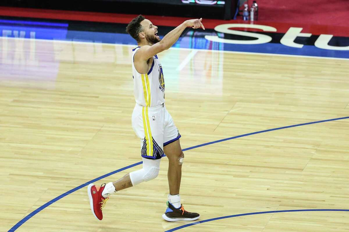 The Golden State Warriors' Steph Curry celebrates after one of his 10 3-pointers amid a 49-point effort against the host Philadelphia 76ers on April 19, 2021. (Steven M. Falk/The Philadelphia Inquirer/TNS)